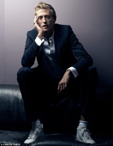 Peter Crouch. In a suit. And unlaced Converse. The cad.