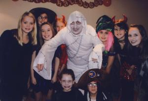 Neil Warnock, dressed as a ghost (or something), surrounded by demonic children