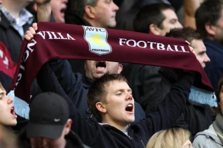 Aston Villa fan, holding scarf