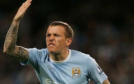 Craig Bellamy raises a polite objection to a disputable call.