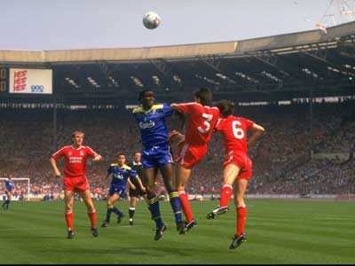 FA Cup final, 1988. Eric Young, Wimbledon, contests a high ball with Gary Ablett and Alan Hansen of Liverpool.