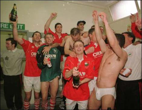 Barnsley, in pants, with champagne, celebrating