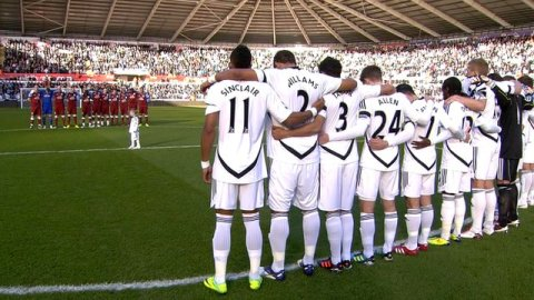 Swansea and Aston Villa players observe a minute of silence in memory of Gary Speed.