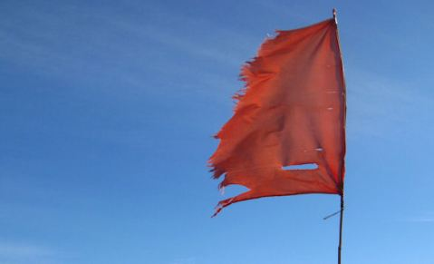 A tattered red flag