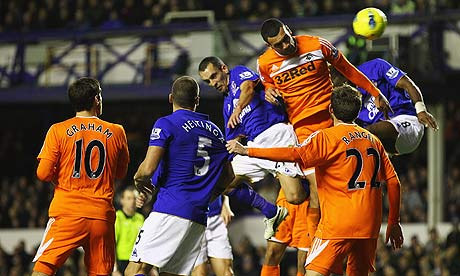 Leon Osman wins a header against Swansea